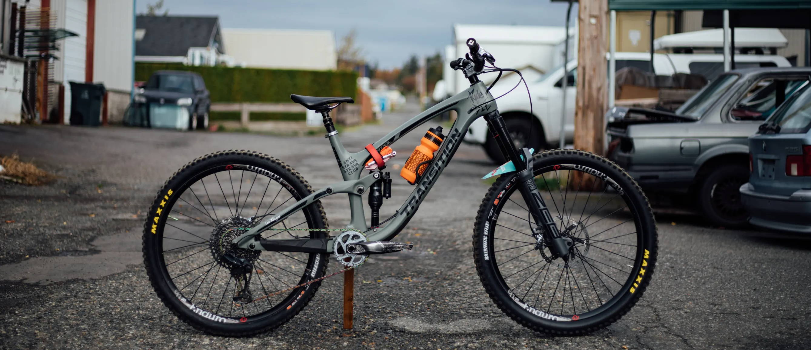 transition patrol bike check  bike in an alley  with a rockshox zeb sram groupset and drivetrain