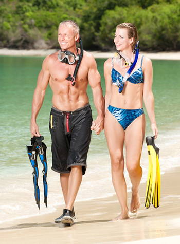 Fit couple walking on the beach