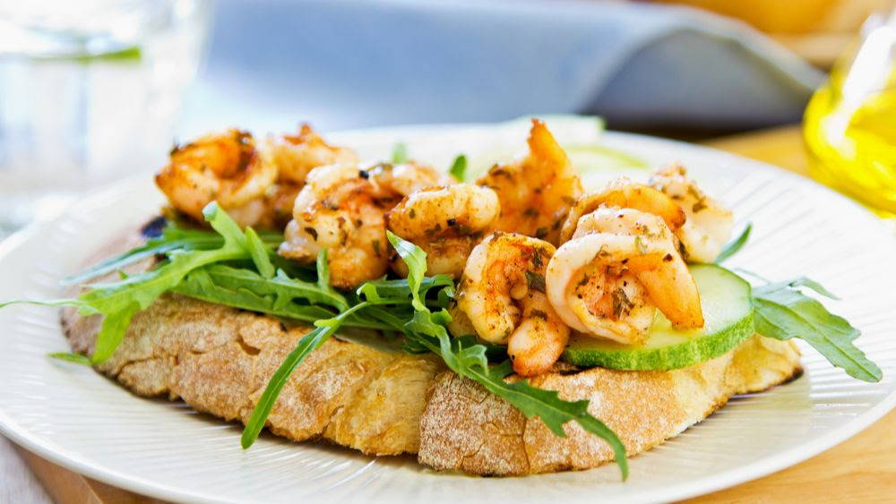 shrimp on toast with arugula and cucumber
