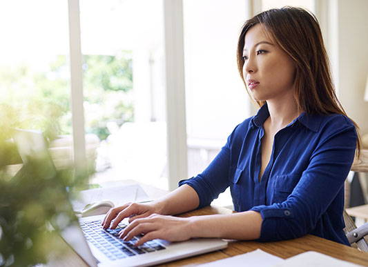 woman-in-an-office-setting-working-on-a-laptop