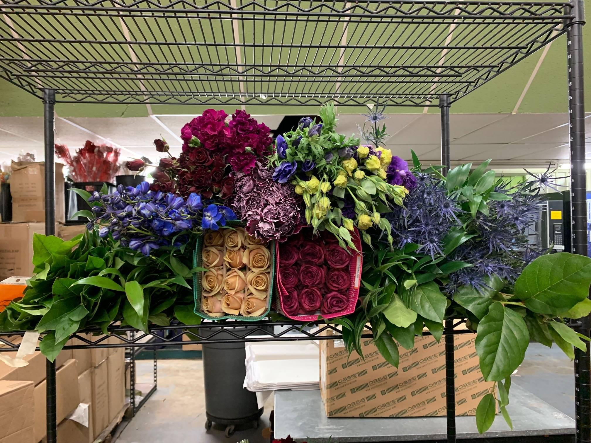 Thistle, Roseberry roses, Golden Mustard roses, salal, purple lisianthus, delphinium, Minerva carnations