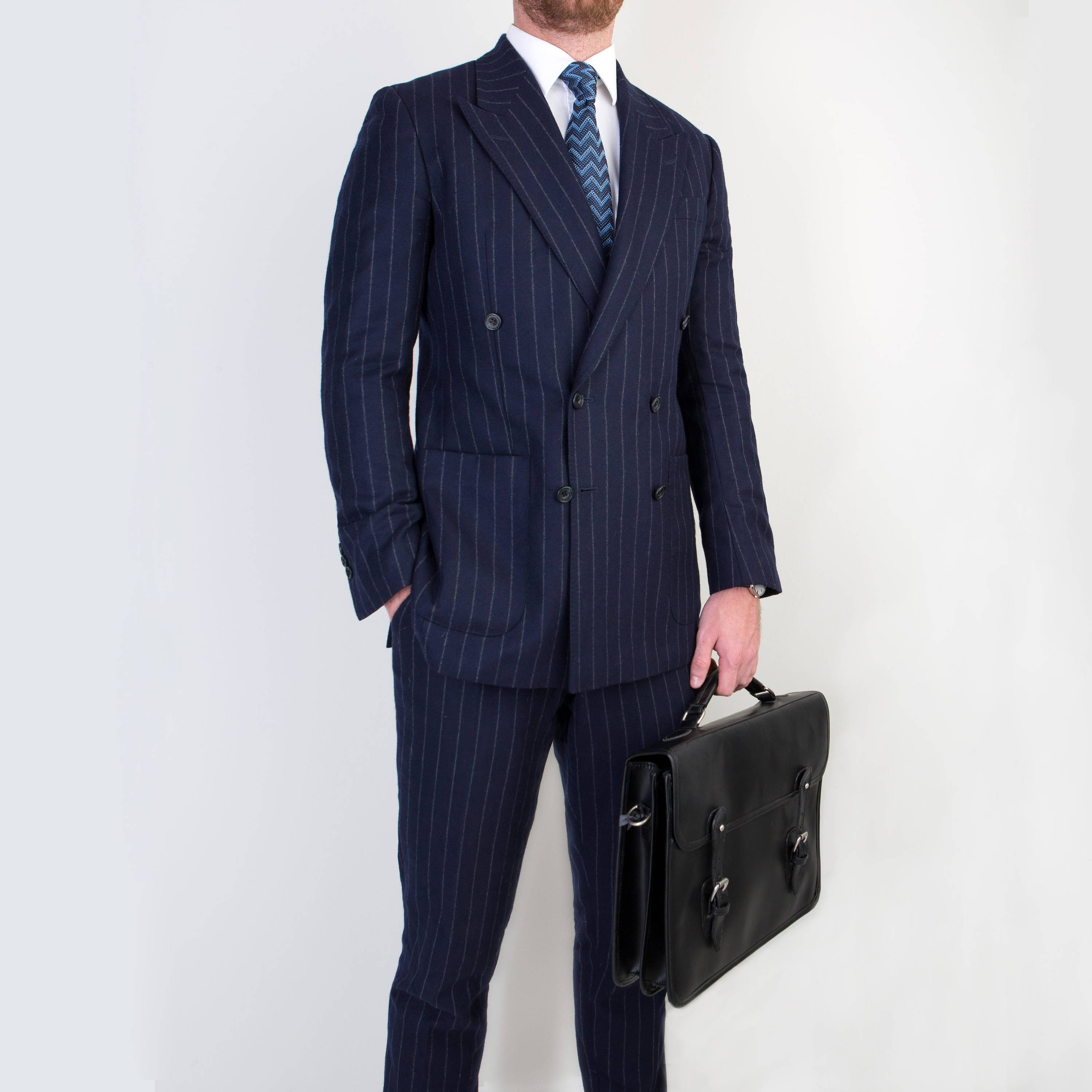 Gentleman wearing double breasted business suit by bespoke tailors Mullen and Mullen