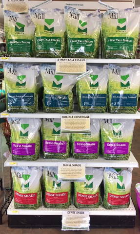 Bags of Mill Grass Seed on a shelf.