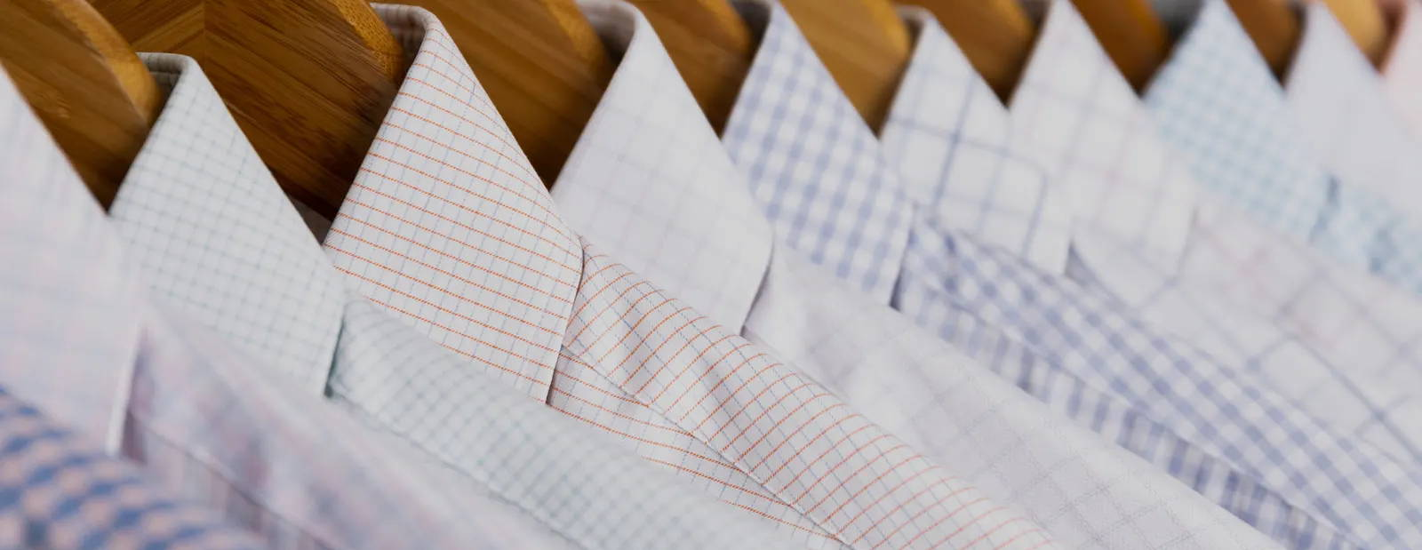 Up close of new Spring dress shirts on hangers