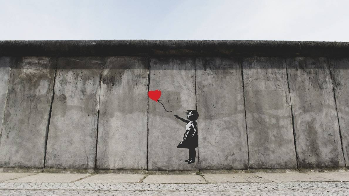 Graffiti art by Banksy girl releases red balloon