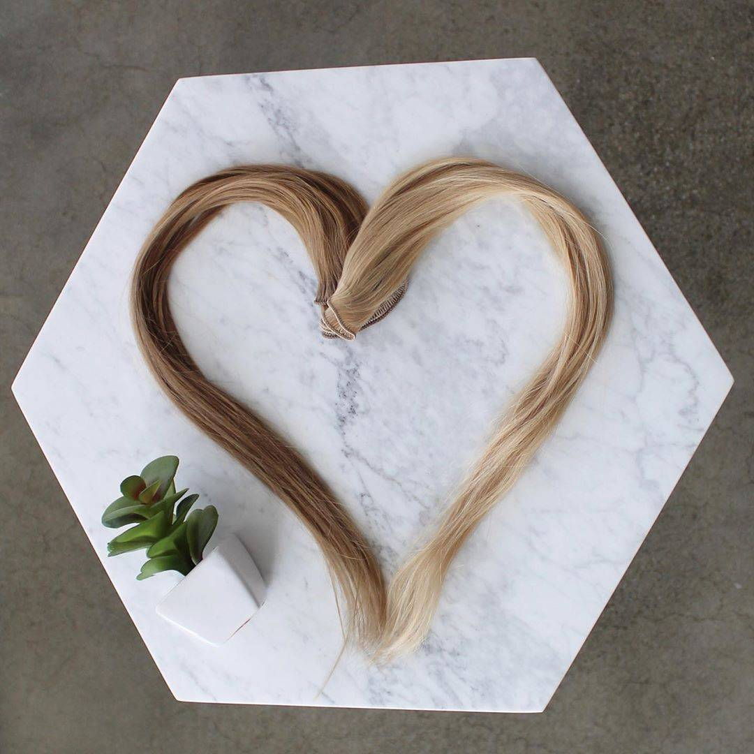 beautiful heart shape ash color hand-tied weft hair extensions with white background color