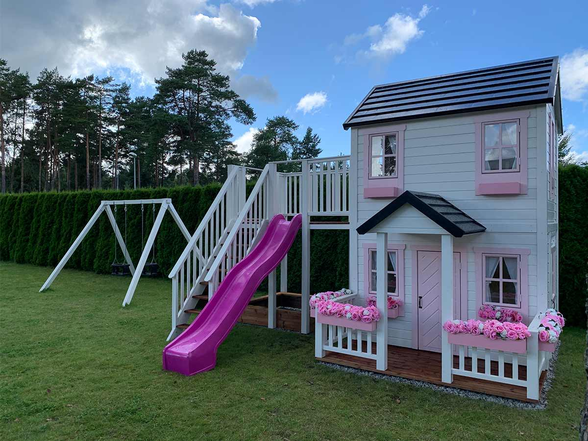 2- storey Custom Wooden Playhouse with pink slide, wooden terrace and flower boxes by WholeWoodPlayhouses