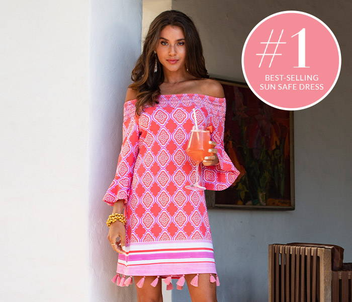 Woman wearing #1 best-selling Coral Geo Off The Shoulder Dress with cocktail
