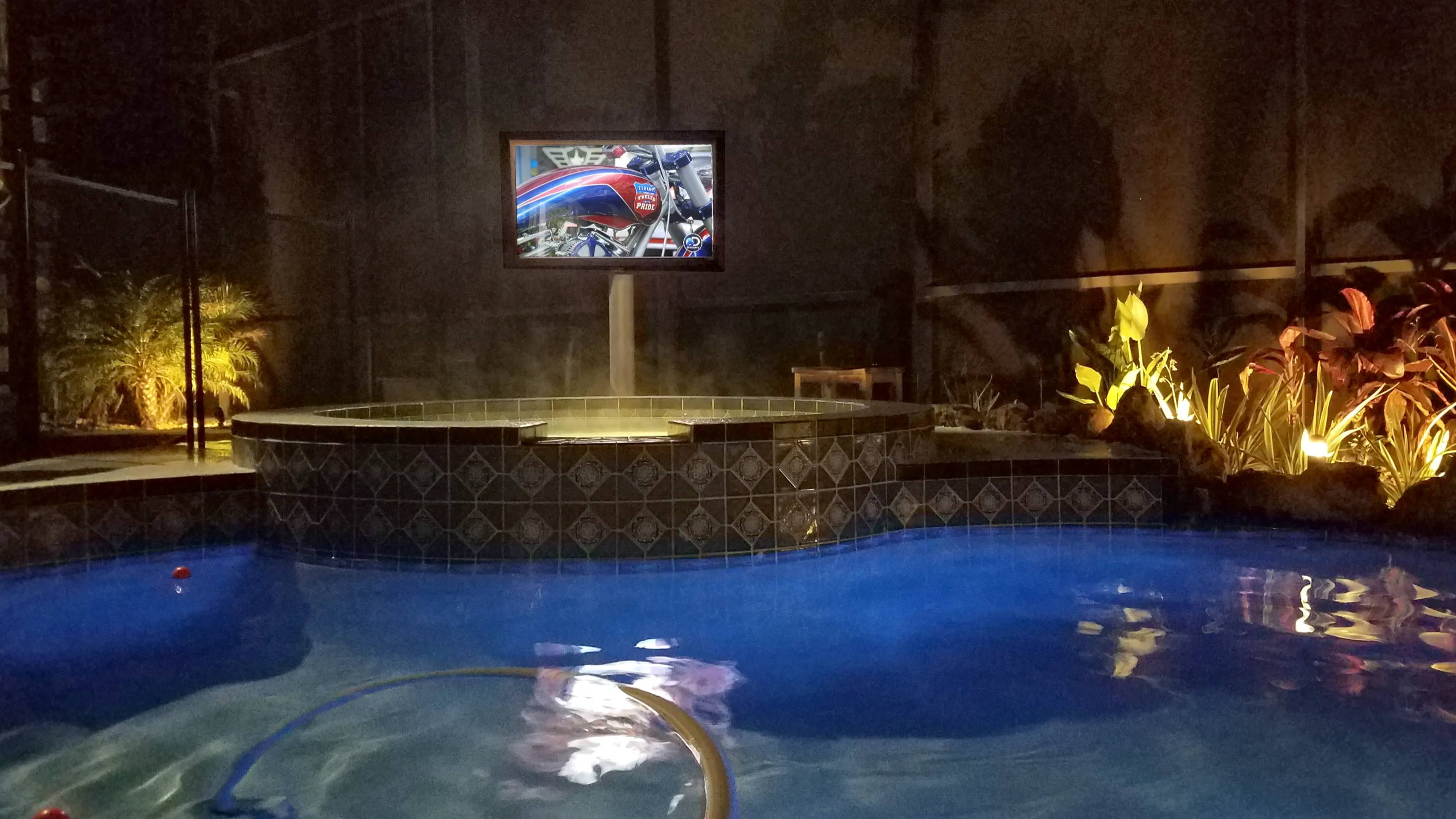 The TV Shield outdoor TV mounting on cart by pool