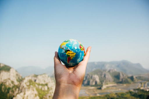 hand holding round planet earth globe