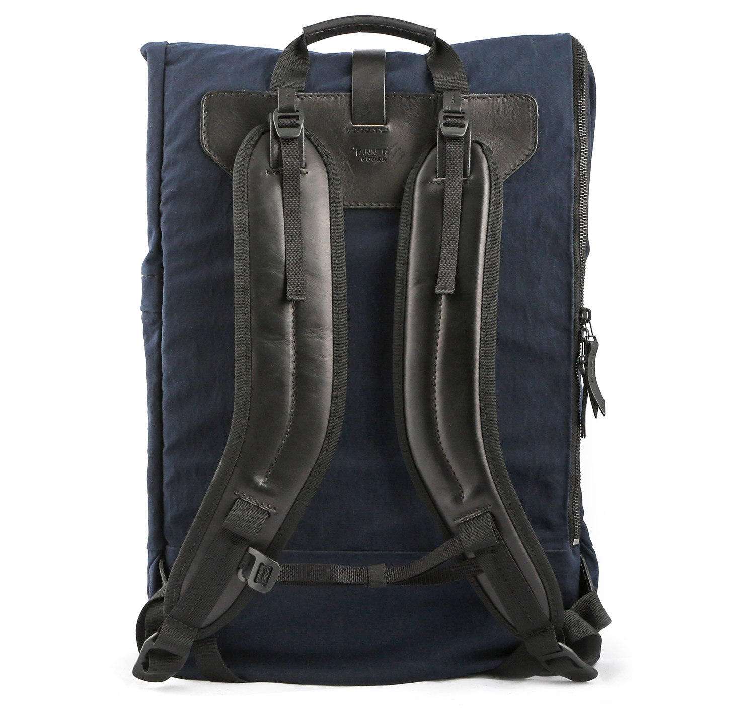 The backside of a navy blue backpack with black straps and accents.