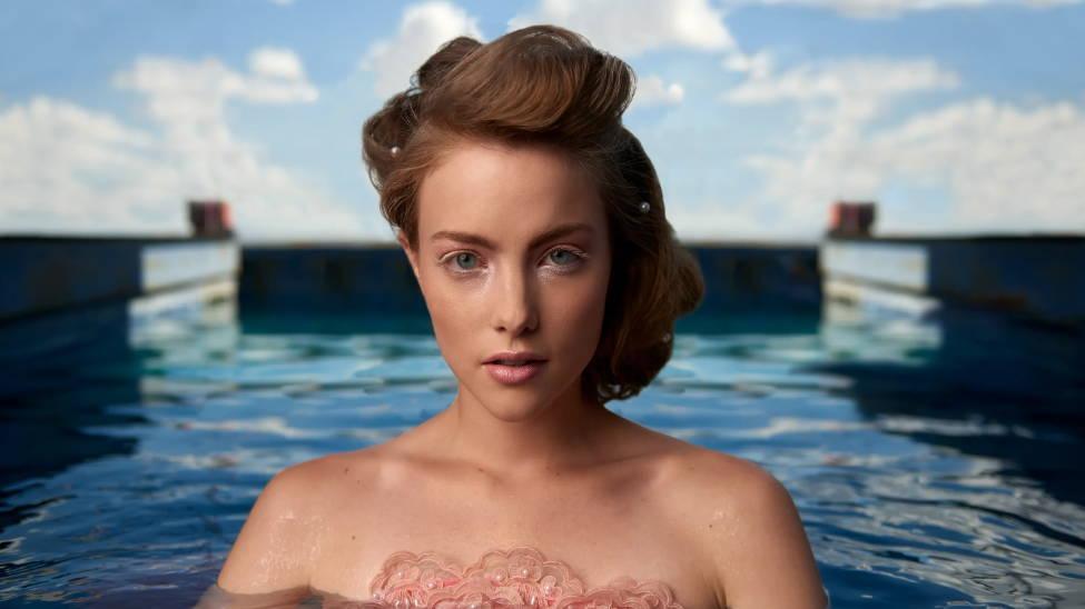 Closeup portrait of a model in a pool