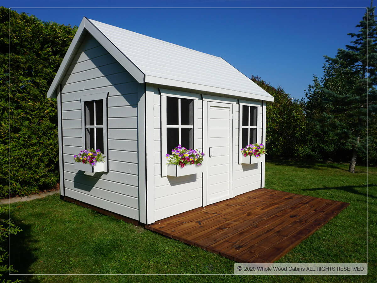 Outside of kids playhouse Arctic Nario |white outdoor playhouse by WholeWoodPlayhouses