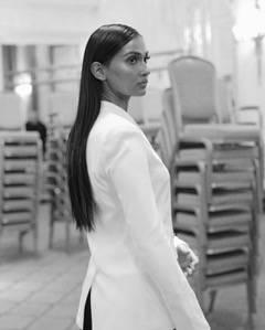 Wana Limar wearing Galvan London White Satin open front blazer