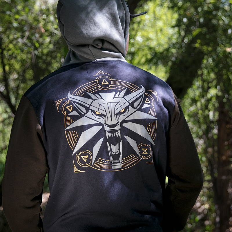 Photo of a male model wearing a Witcher hoodie