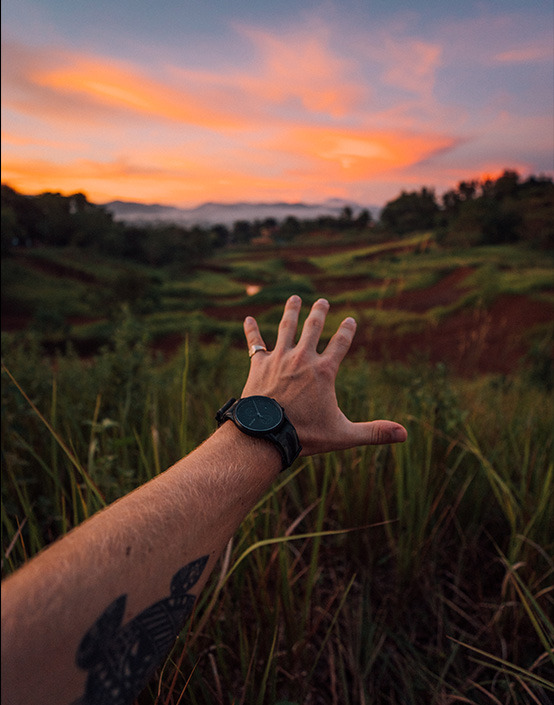 first person view wrist shot of watch in jungle