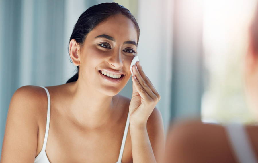 woman removing makeup with coconut oil