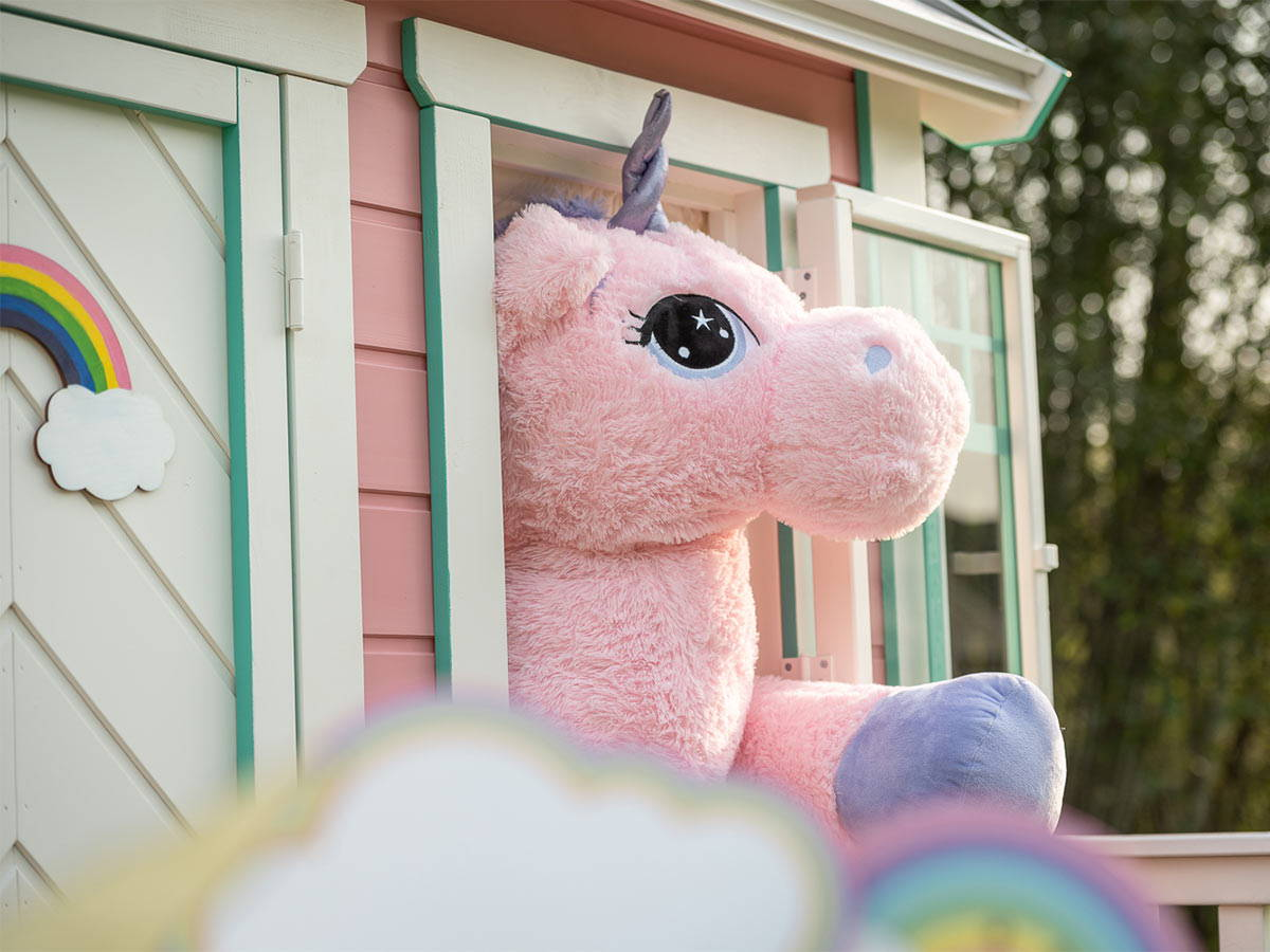 Wooden Playhouse in pink color with  unicorn at the window  by WholeWoodPlayhouses