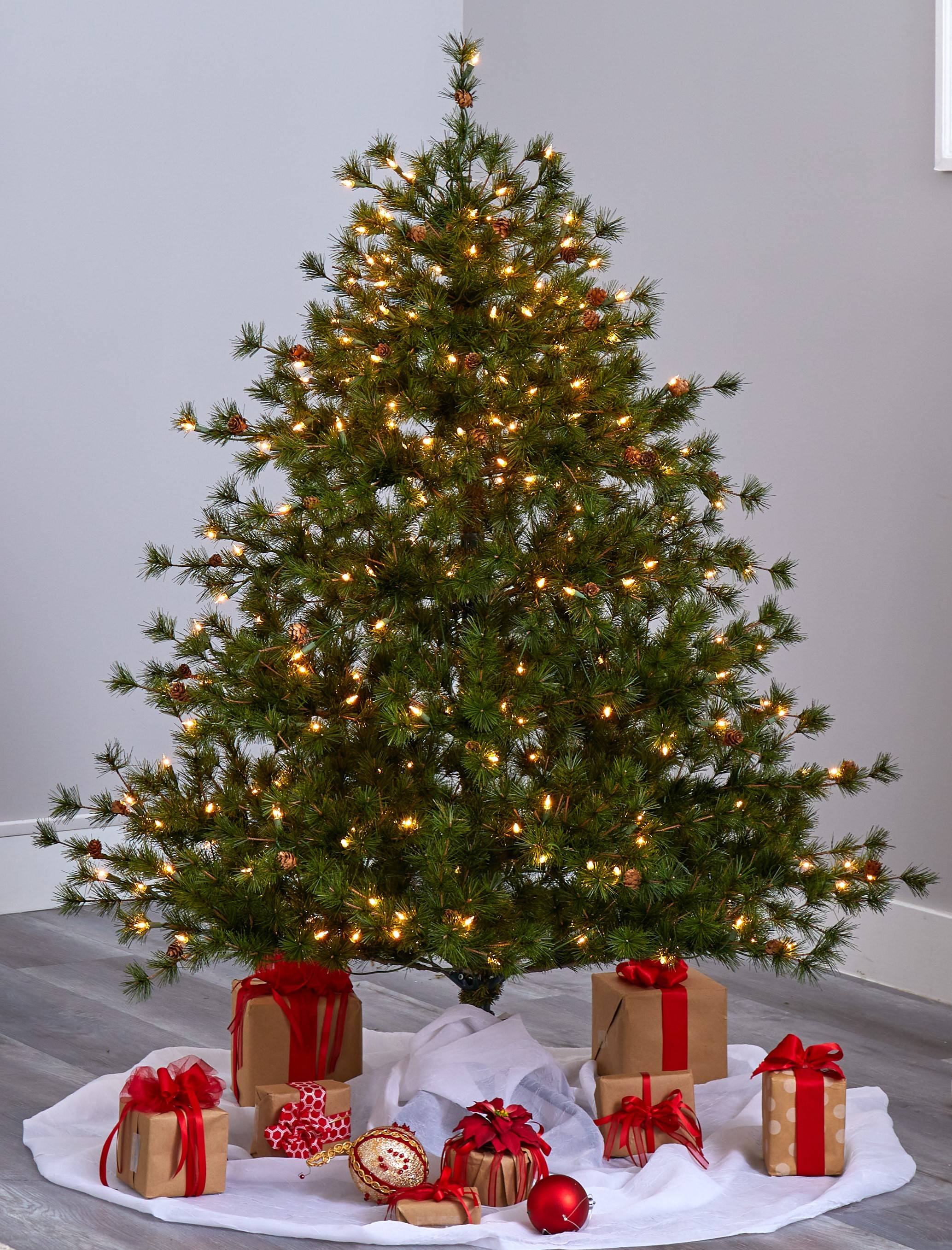 A Christmas tree with Christmas and holiday gifts under the tree