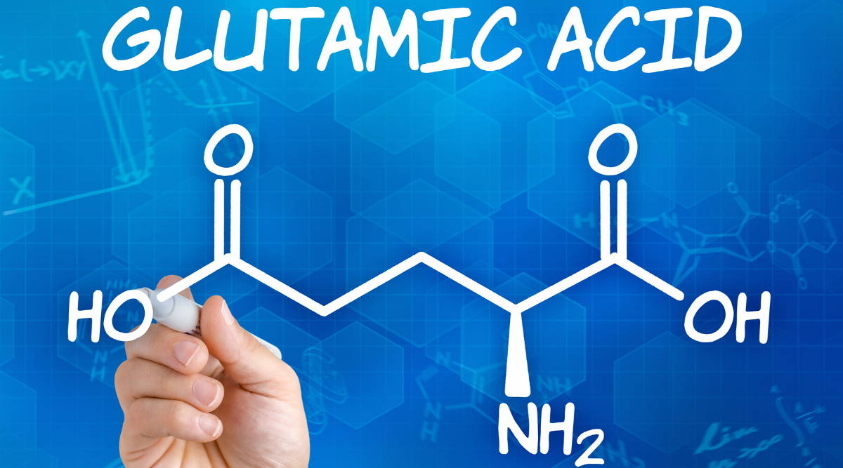 Hand with pend drawing the chemical compound of glutamic acid|Benefits of blutamic acid