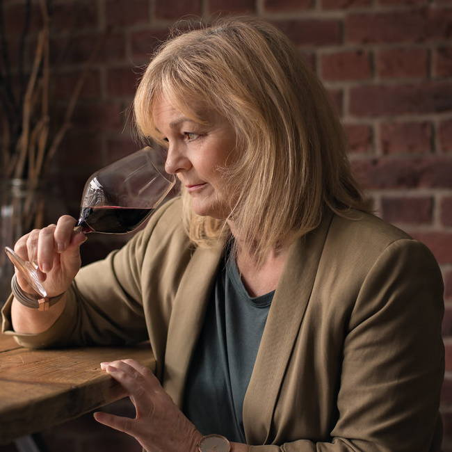 Gillian Mann tasting red wine at Jaded Palates