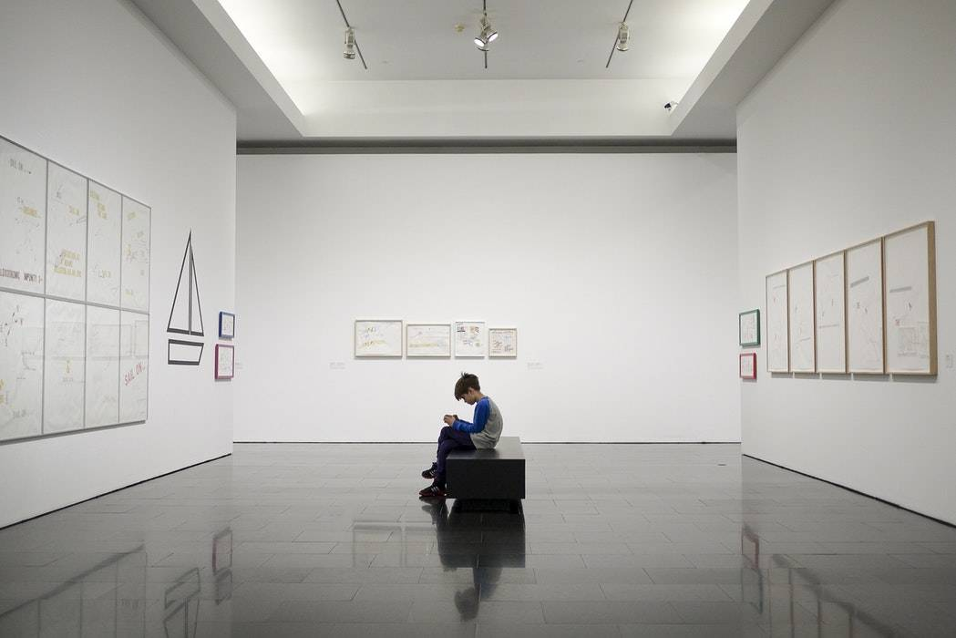 Boy sitting in the art gallery