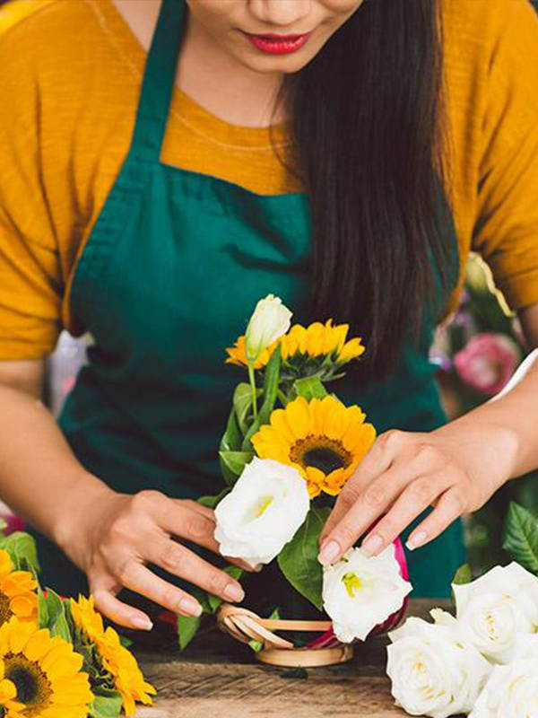 florist with yellow sunflower