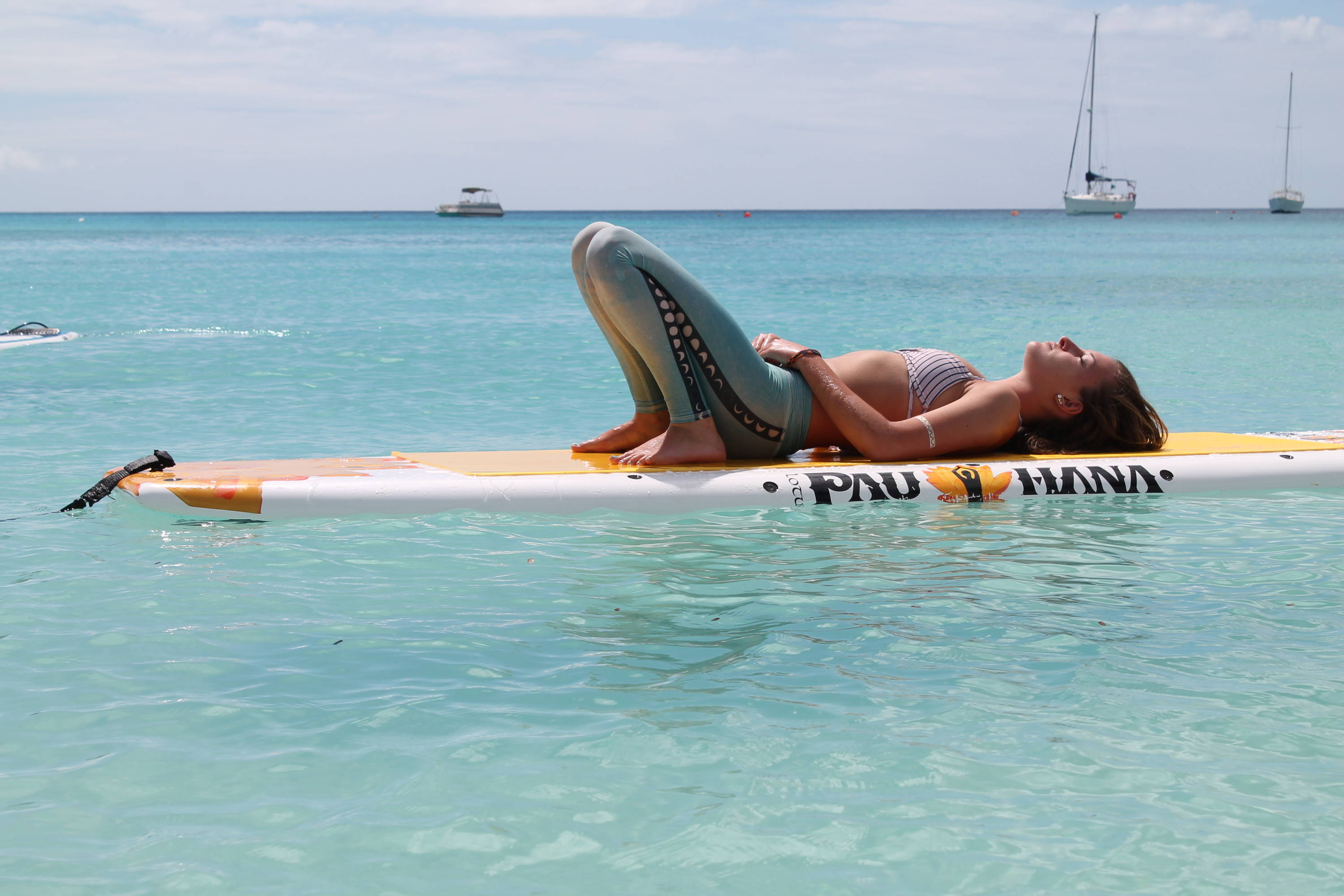 Relaxing on the yoga stand up paddle board