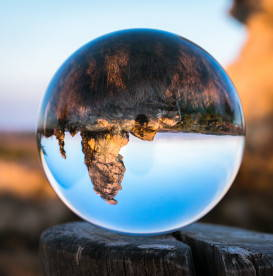 perspective-upside-down-mountain-reflection-in-crystal-ball