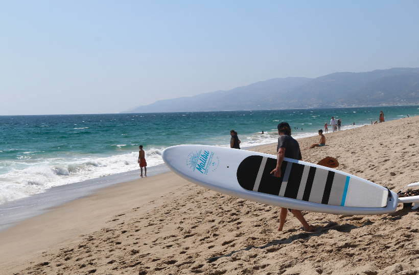 The Malibu is the best beginner stand up paddle board on the market. Malibu SUP by Pau Hana on the beach