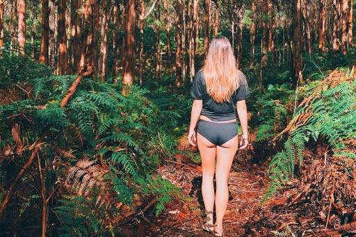 Beautiful young woman wearing WAMA hemp underwear in the woods