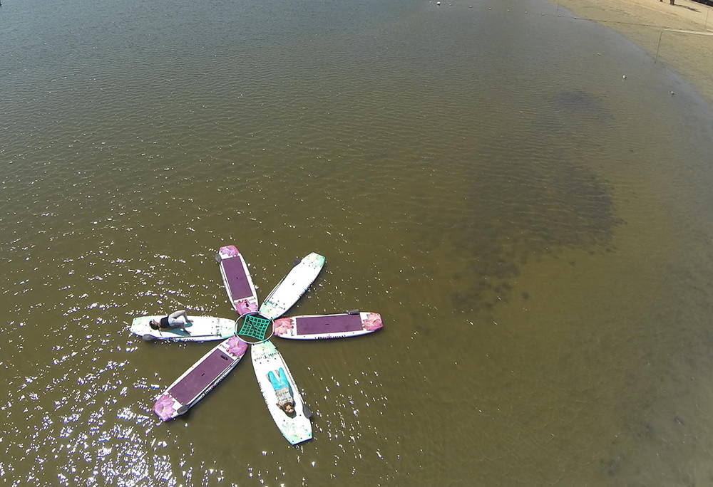 Yoga class with the Pau Hana Lotus Boards on the water in Venice
