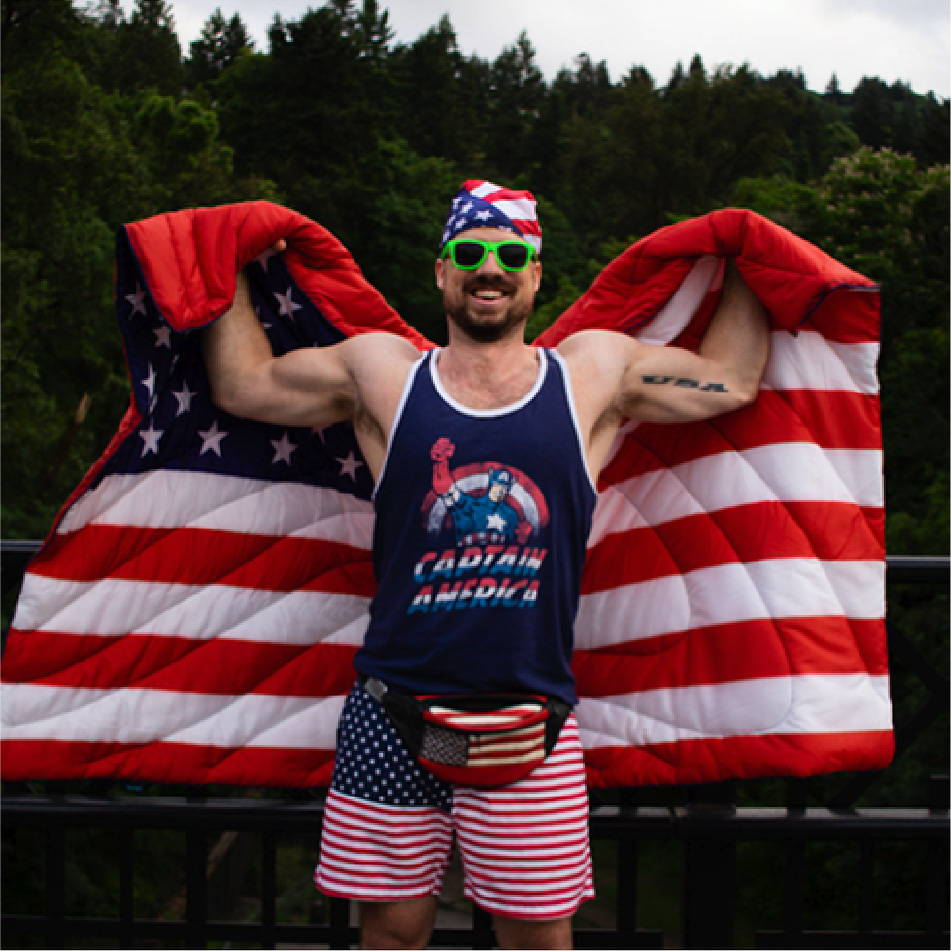 John Pinney wearing American flag Rumpl and Chubbies