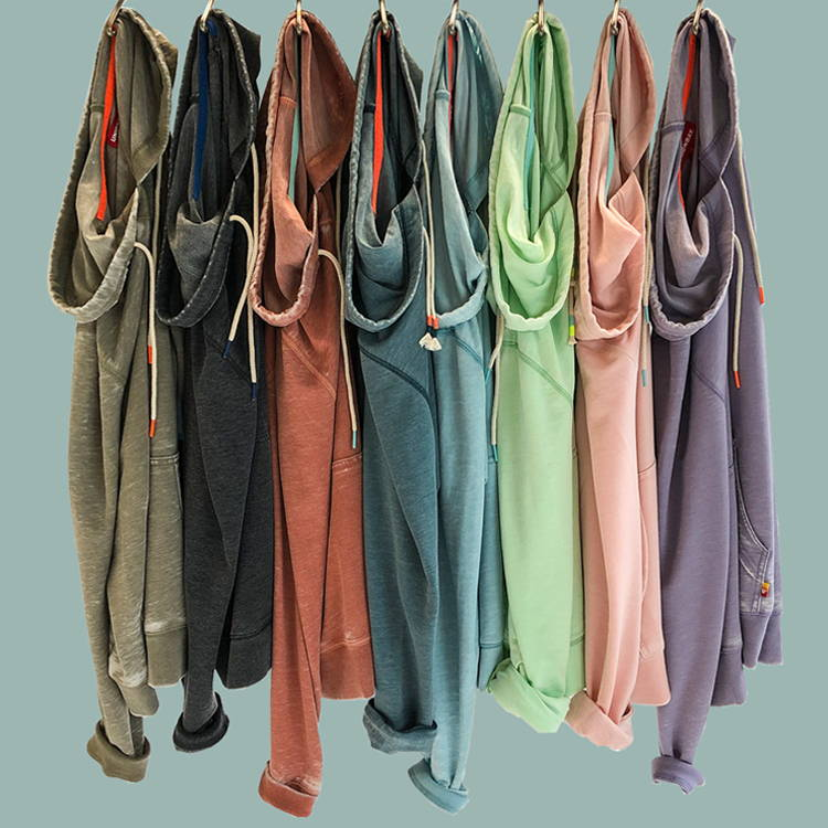 Different colored men's hoodies hanging on hooks