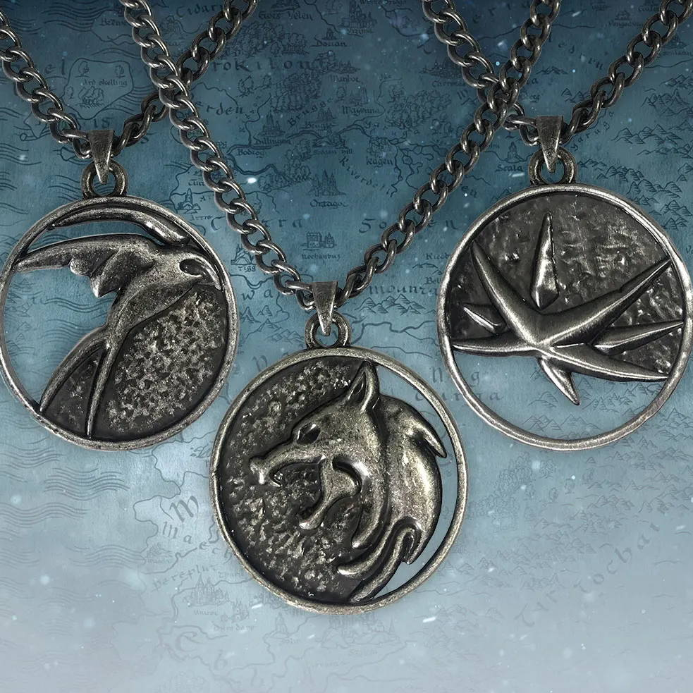 An image of three Netflix: The Witcher medallion necklaces