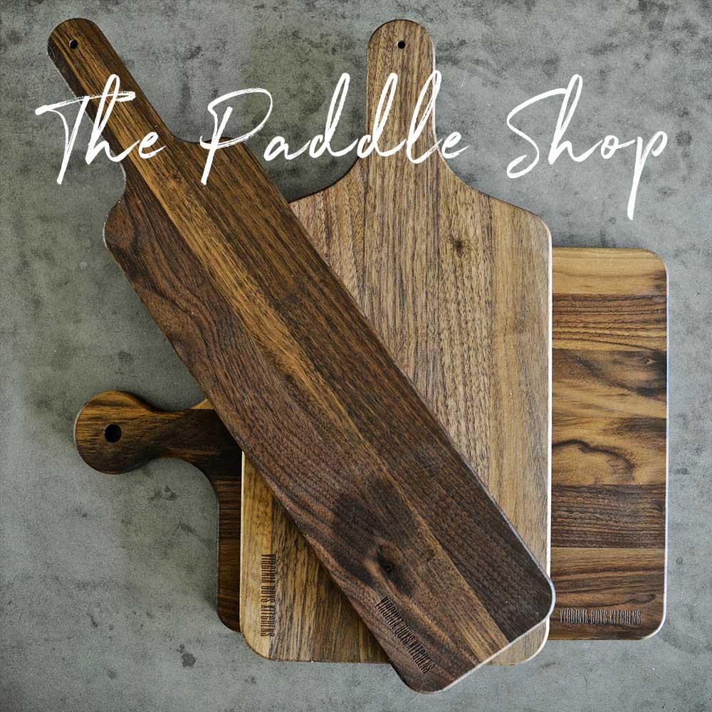 A collection of walnut wood paddle boards