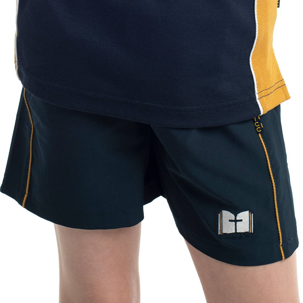 Unisex sports shorts featuring piping, embroidery and a custom pip tag for Toongabbie Christian College.