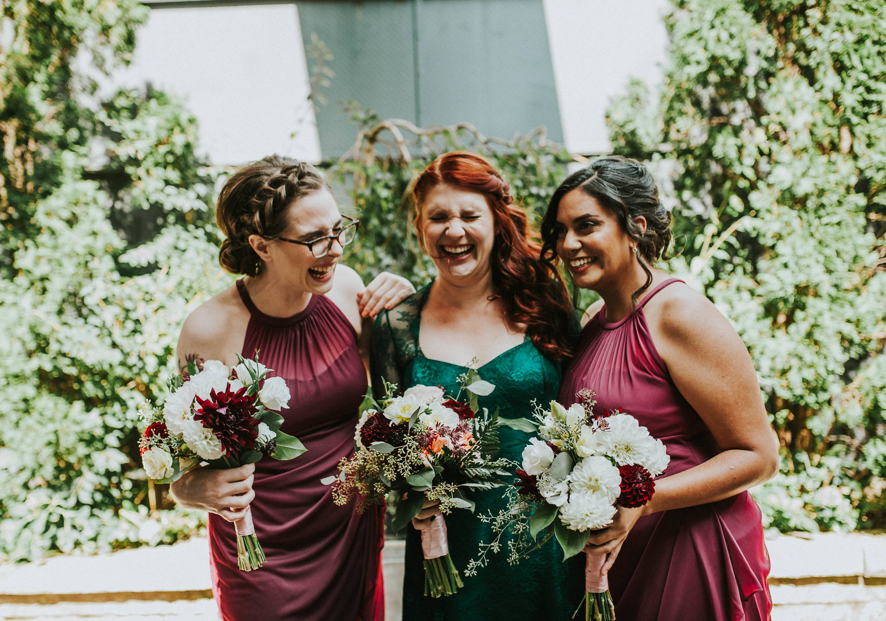 A bride and her bridesmaids with their flower bouquets at Le Select Bistro in Toronto