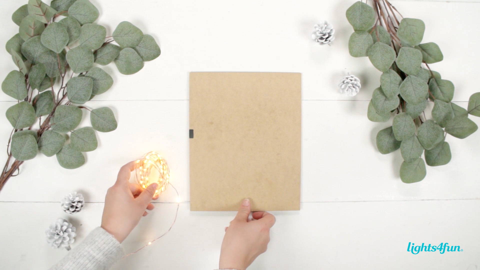 A DIY step of the Scandi Christmas decoration tutorial. Decorating the backboard with micro fairy lights.