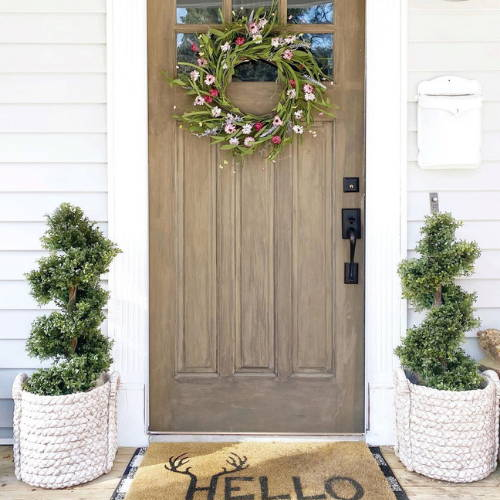 Nearly Natural topiary trees decorated at the entrance door