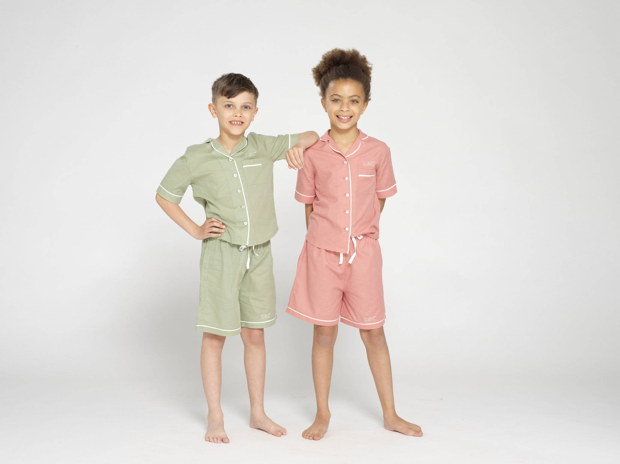 Two kids wearing their very own Look And Cover Pyjamas