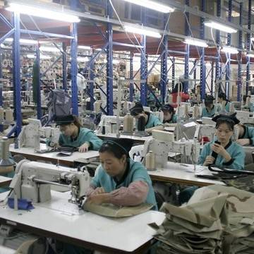 Women working hard in a crowded clothing factory