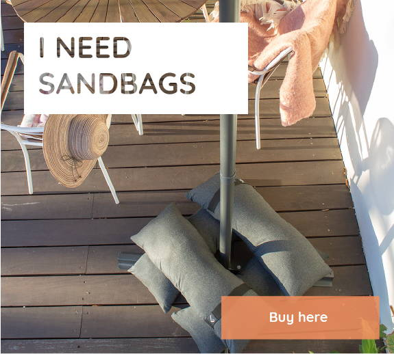 Four Baser sandbags are piled up on top of a cantilever parasol