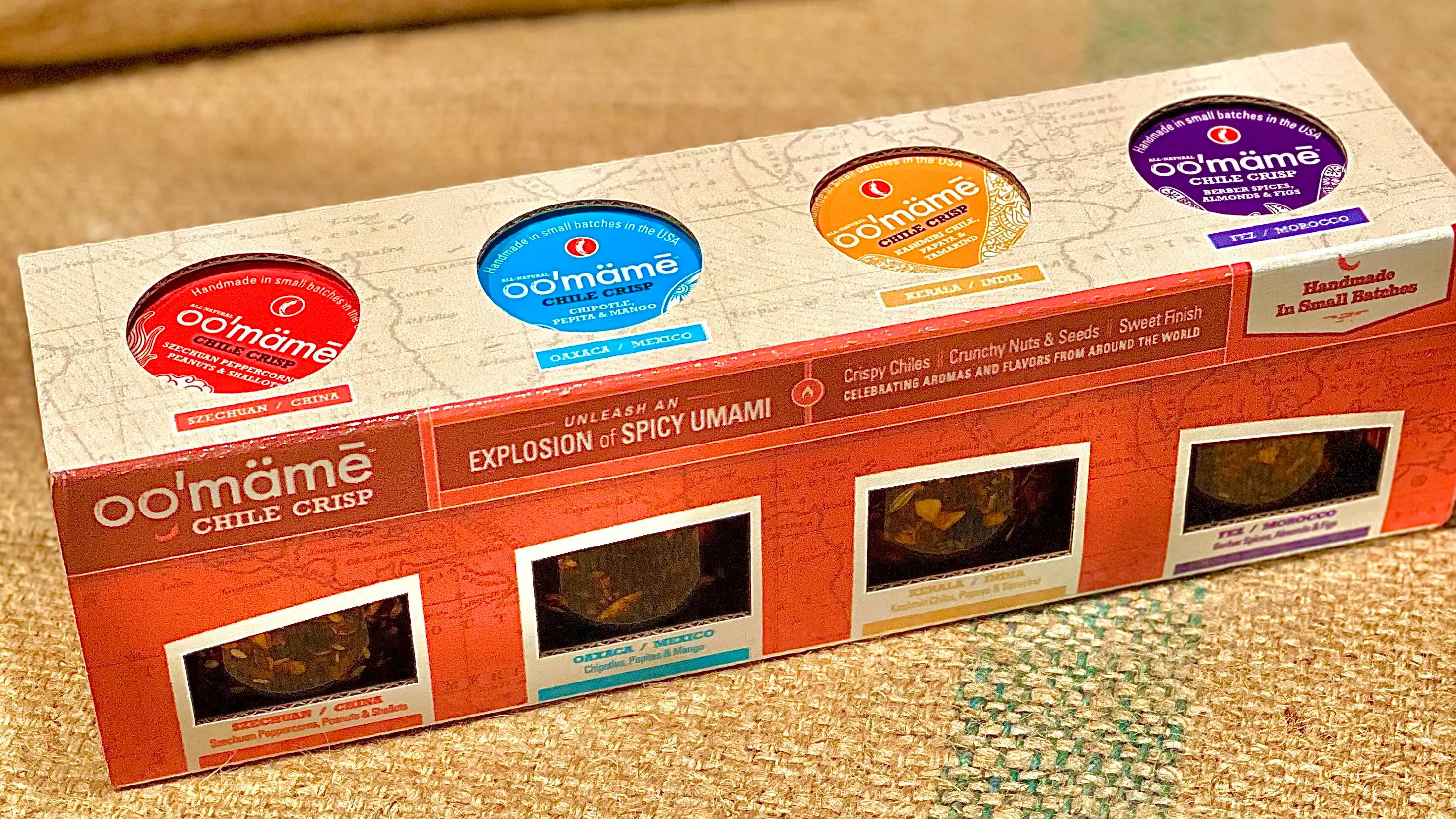 gift box of 4 flavors of oo'mämē chile crisp on burlap background
