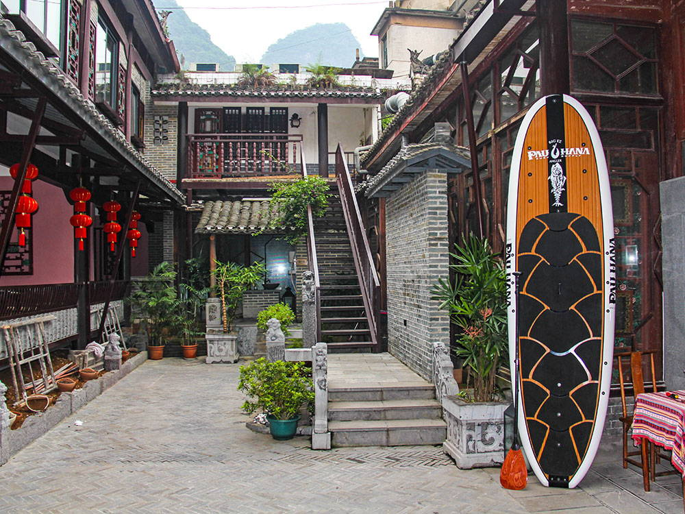 Paddleboard outside of house in China