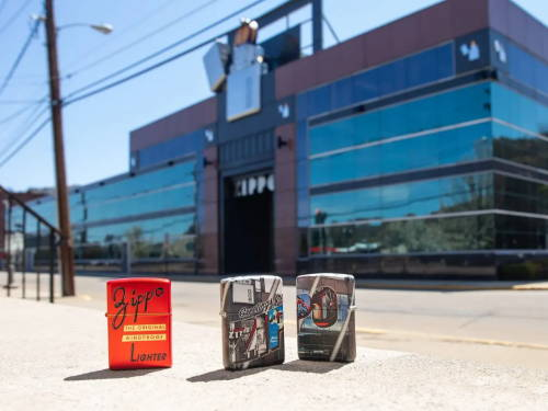Zippo Red Box Top Design and Greetings from Zippo 540 design lighters standing in front of the Zippo headquarters in Bradford, PA.