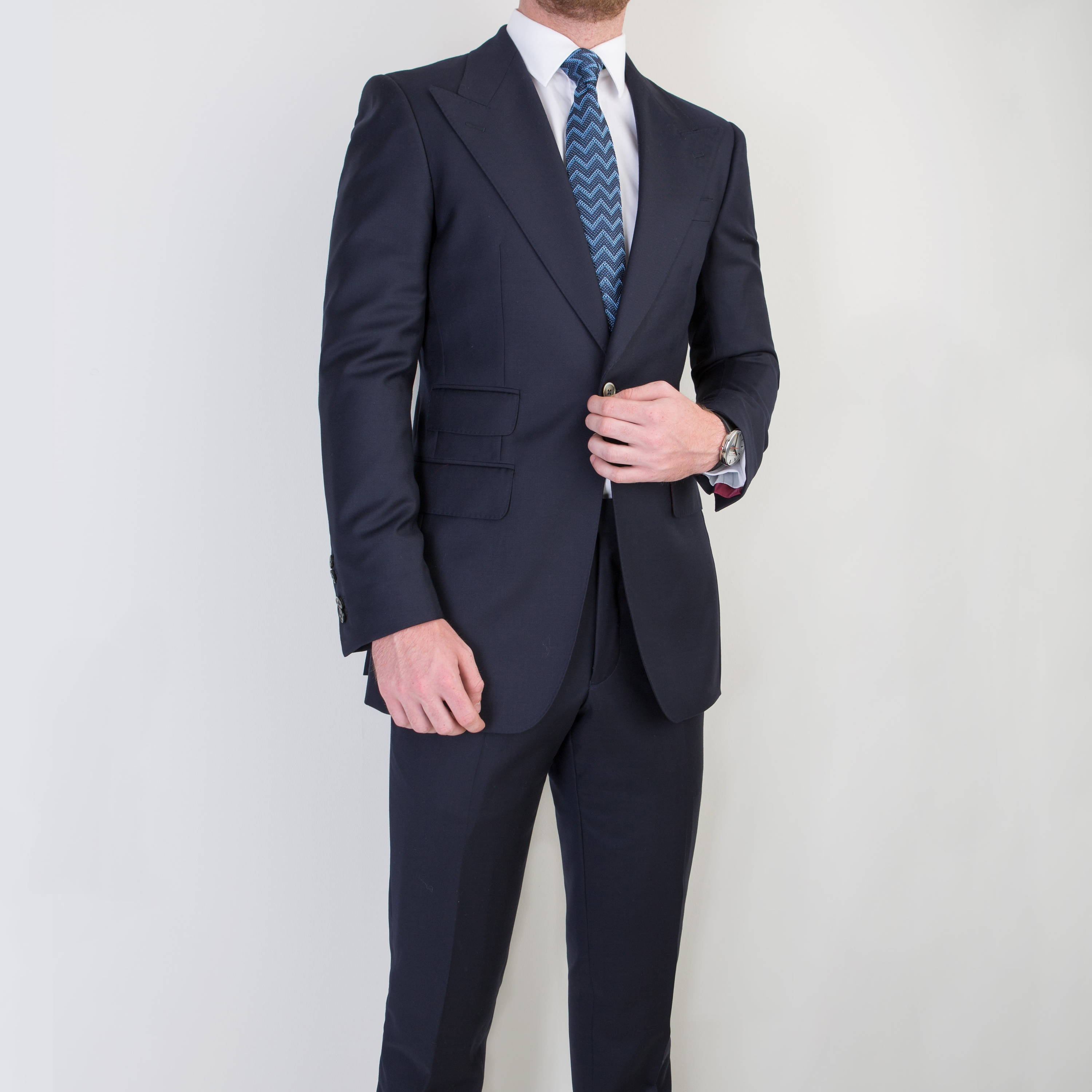 Model wearing Mullen and Mullen bespoke tailored single breasted suit