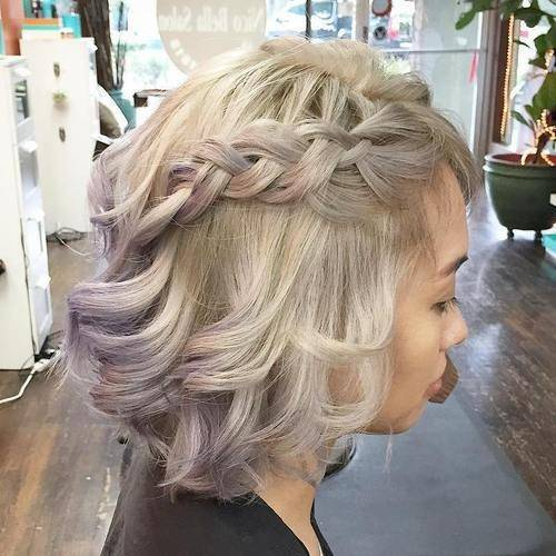 Woman with curly bob and side braid