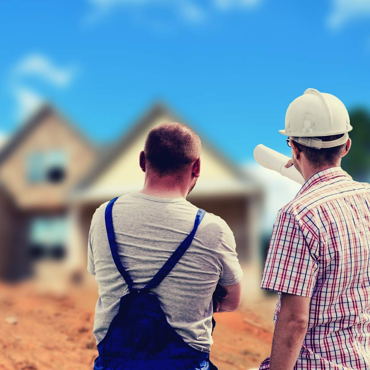 builders looking at a house