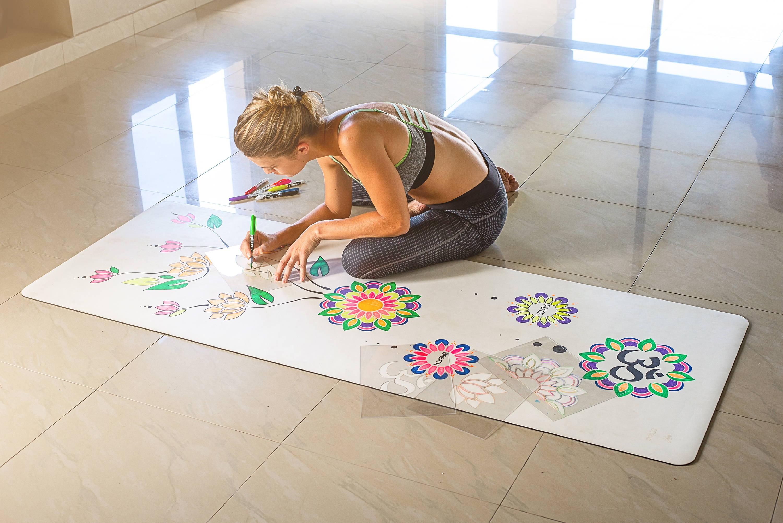 White customisable yoga mat by DIYogi being personalised using markers